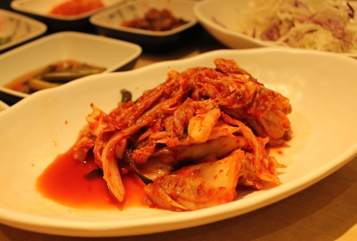 Kimchi stew goes especially well with what else, but kimchi